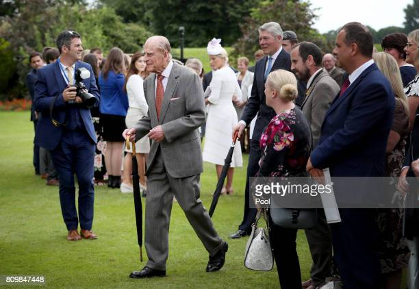 The Duke of Edinburgh attends the Presentation Reception for The Duke of Edinburgh Gold Award holders in the gardens at the Palace of Holyroodhouse...