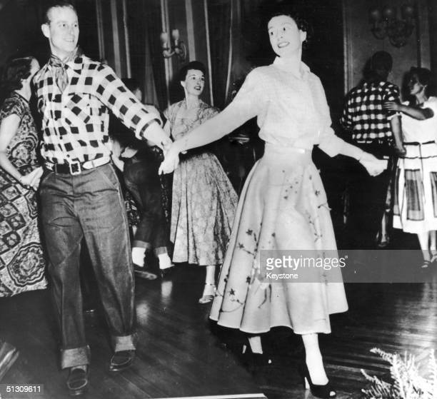 The Duke of Edinburgh dances with his wife Princess Elizabeth at a square dance held in their honour in Ottawa by Governor General Viscount Alexander...