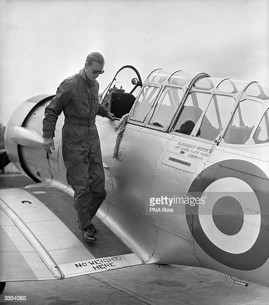 The Duke of Edinburgh disembarks from a North American Harvard Trainer aircraft after a flight, at RAF White Waltham, Berkshire, where he has been...
