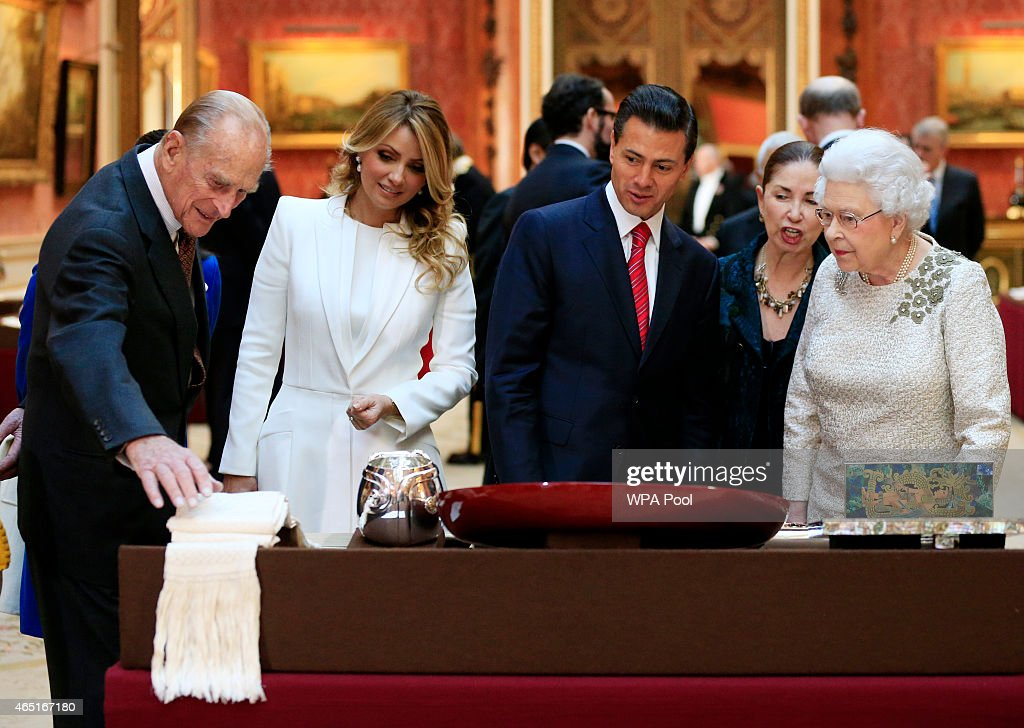 The Duke of Edinburgh (first left) First Lady of Mexico Angela Rivera (second left) President of Mexico Enrique Pena Nieto (third left) and Queen Elizabeth II (first right) view a display of Mexican items in the Royal Collection by at Buckingham Palace on March 3, 2015 in London, England. The President of Mexico, accompanied by Senora Angelica Rivera de Pena, are on a State Visit to the United Kingdom as the guests of Her Majesty The Queen from Tuesday 3rd March to Thursday 5th March.