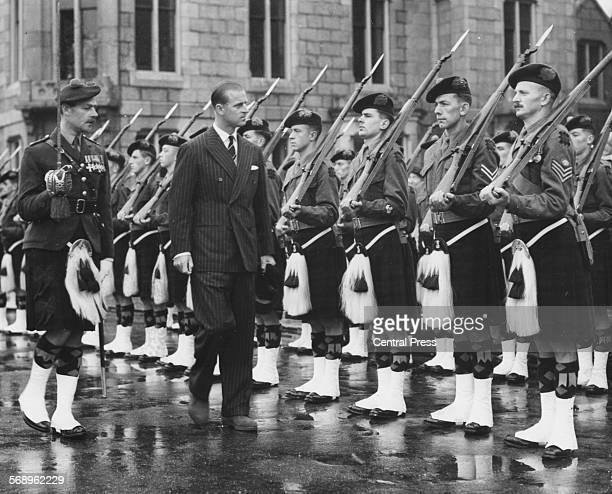 The Duke of Edinburgh inspecting a Guard of Honor of the 2nd Battalion Black Watch, at Ballater Station on the way to Balmoral, Scotland, August 9th...