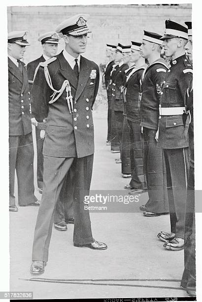 The Duke of Edinburgh is shown inspecting cadets at the Royal Naval College Dartmouth Devon He also unveiled a plaque commemorating the departure...