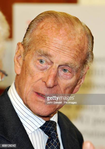 The Duke of Edinburgh listens to a description of the VK1 an aerial gravity mapping tool that finds underground minerals from a low flying aircraft...