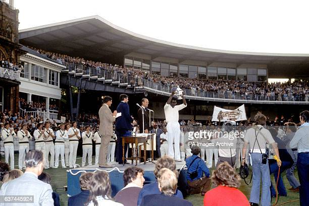 HRH The Duke of Edinburgh looks on as West Indies captain and Man of the Match Clive Lloyd holds the Prudential World Cup aloft after his team won...