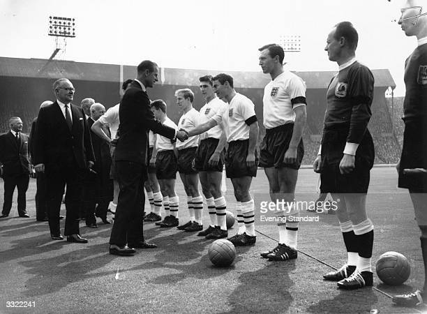 The Duke Of Edinburgh meets the England football team at Wembley for their game against Scotland which they won by 93