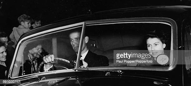 The Duke of Edinburgh pictured at the wheel with Princess Elizabeth in the passenger seat of their car as they leave Clarence House after bidding...