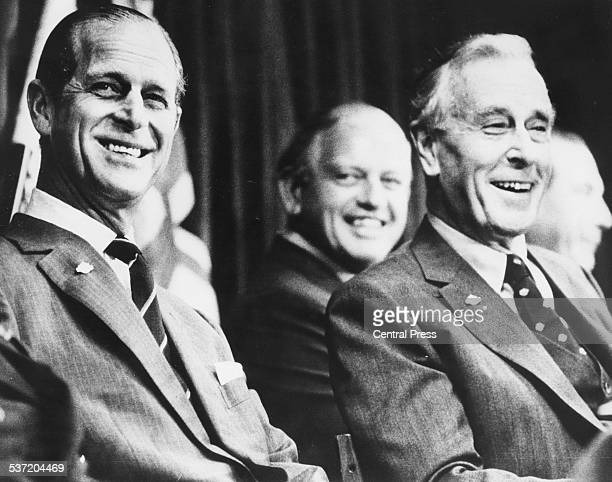 The Duke of Edinburgh Prince Philip and Earl Mountbatten, laughing at the opening of the Triennial Conference of the British Commonwealth,...