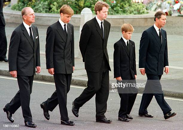 The Duke of Edinburgh Prince William Earl Spencer Prince Harry and Prince Charles walk outside Westminster Abbey during the funeral service for Diana...