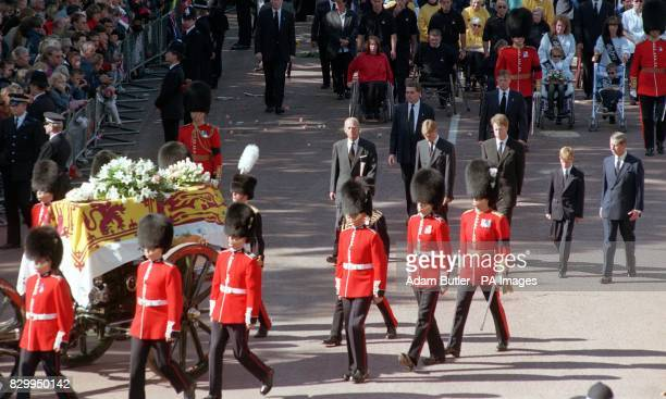 The Duke of Edinburgh Prince William Earl Spencer Prince Harry and the Prince of Wales follow the coffin of Diana Princess of Wales outside...