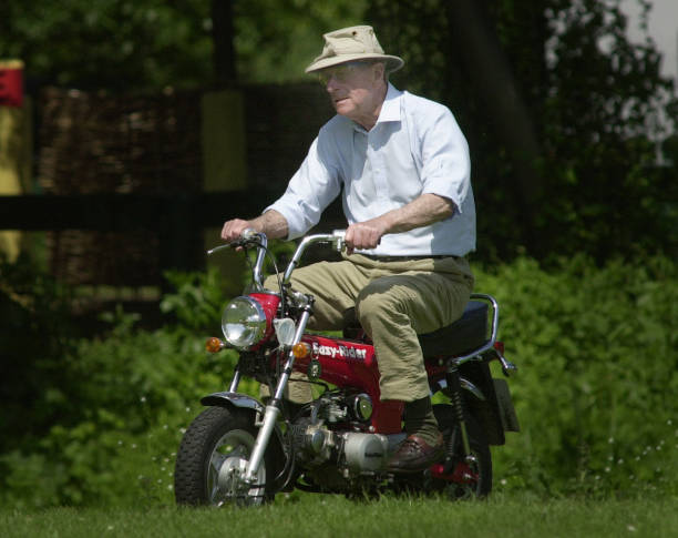 The Duke Of Edinburgh Rides A Mini Motorbike Around Royal Windsor Horse Show On