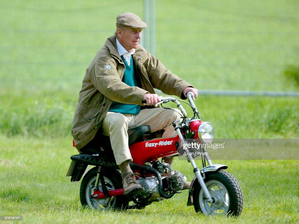 The Duke Of Edinburgh Rides On His Mini Motorbike During Royal Windsor Horse Show At