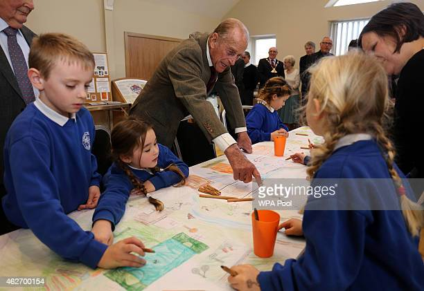 The Duke of Edinburgh speaks with pupils from Burnham Market Primary School during a visit to officially open the South Creake Memorial Pavillion on...