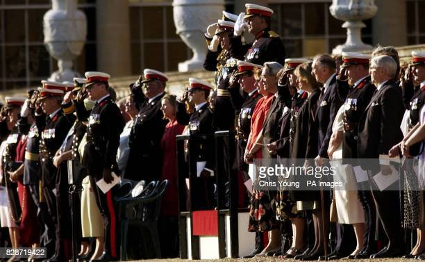 The Duke of Edinburgh standing with Major General Milton and Admiral Sir Alan West, salutes the Last Post, in the Gardens of Buckingham Palace. * The...