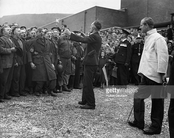 The Duke of Edinburgh stands in the rain to listen to the Fernhill colliery surface choir sing in the traditional Welsh way He is on his way from the...