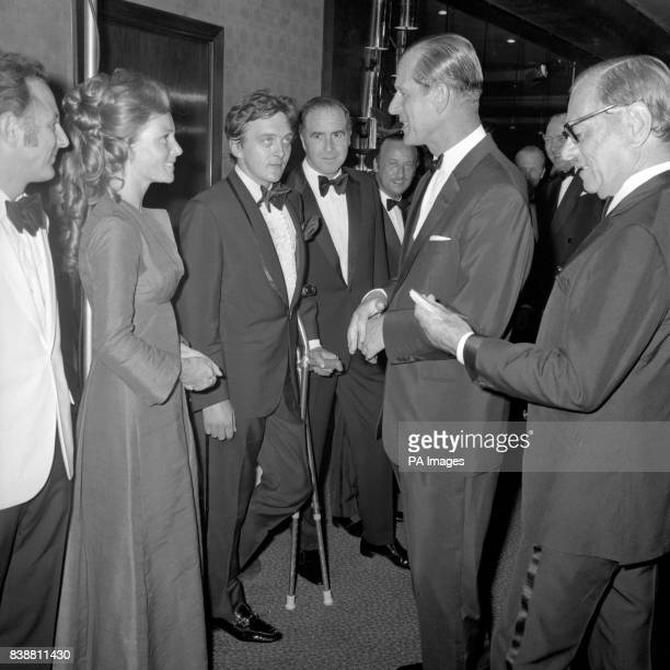 The Duke of Edinburgh talking to Prunella Ransome and actor David Hemmings at the premiere of the film 'Alfred the Great'