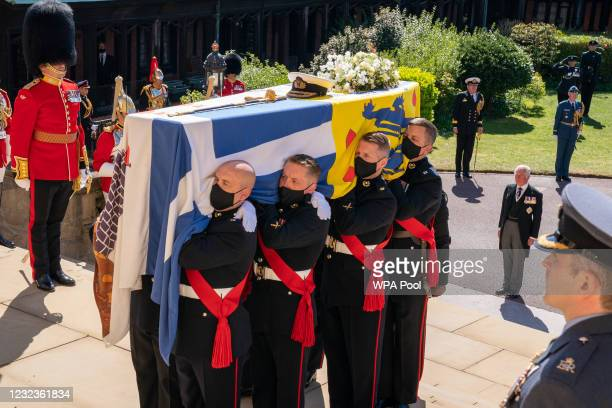 The Duke of Edinburgh's coffin, covered with His Royal Highness's Personal Standard arrives at St George's Chapel carried by the pallbearers during...