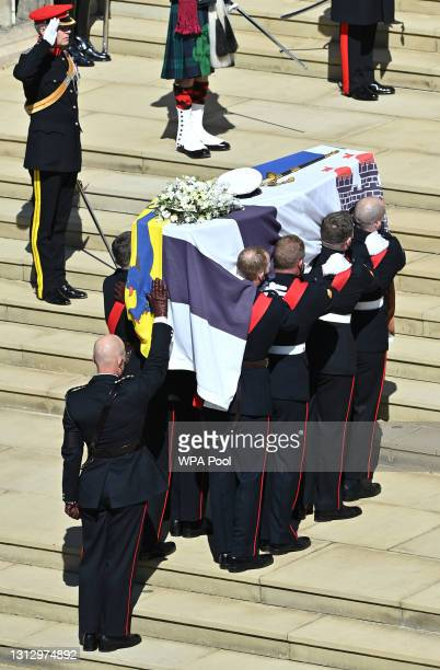 The Duke of Edinburgh's coffin, covered with His Royal Highness's Personal Standard arrives at St George's Chapel carried by a bearer party found by...