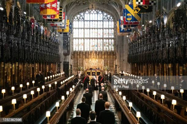 The Duke of Edinburgh's coffin, covered with His Royal Highness's Personal Standard is carried into The Quire in St George's Chapel by the...