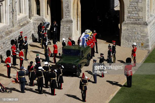 The Duke of Edinburgh's coffin, covered with His Royal Highness's Personal Standard is carried to the purpose built Land Rover during the funeral of...