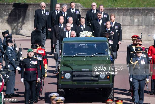 The Duke of Edinburgh's coffin, covered with His Royal Highness's Personal Standard is seen on the purpose built Land Rover, followed by Princess...