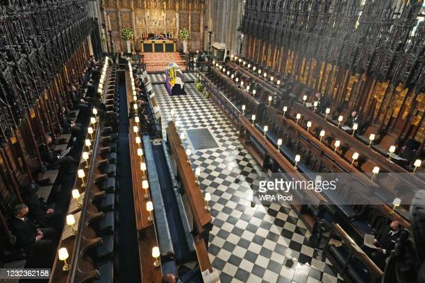 The Duke of Edinburgh's coffin, covered with His Royal Highness's Personal Standard lies in St George's Chapel during the funeral of Prince Philip,...