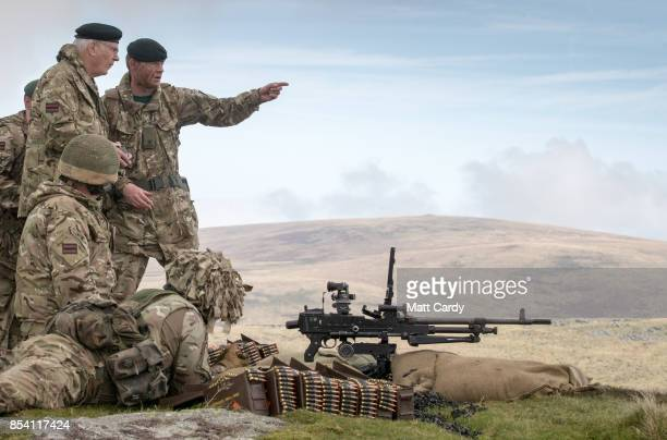 The Duke of Gloucester chats with soldiers at a live firing point during his visit to Okehampton Camp Dartmoor during the 6th Battalion The Rifles'...