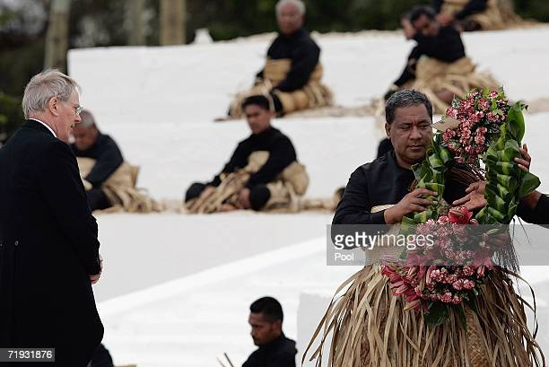 The Duke of Gloucester watches as the royal undertaker receives his wreath for the tomb of the late King Taufa'ahau Tupou IV at his state funeral on...