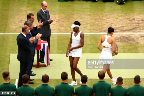 The Duke of Kent and the presentation party applaud winner Garbine Muguruza of Spain and runnerup Venus Williams of The United States after the...