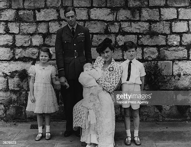 The Duke of Kent George Edward Alexander Edmund with the Duchess and their children at the christening of their third baby Original Publication...