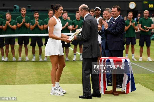 The Duke of Kent presents the winners trophy to Garbine Muguruza of Spain after the Ladies Singles final against Venus Williams of The United States...