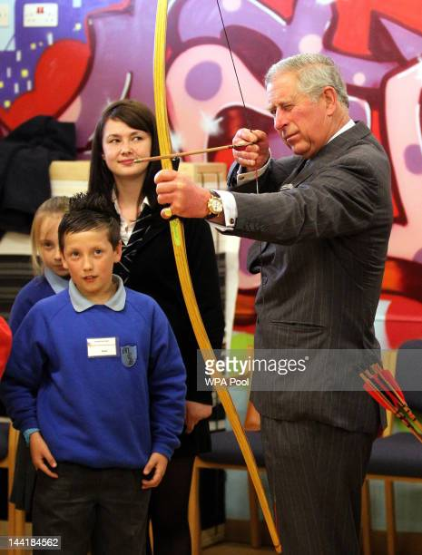 The Duke of Rothesay tries his hand at archery has a shot archery watched by Jason Wilson and archery coach Jim McPike during a visit to the North...