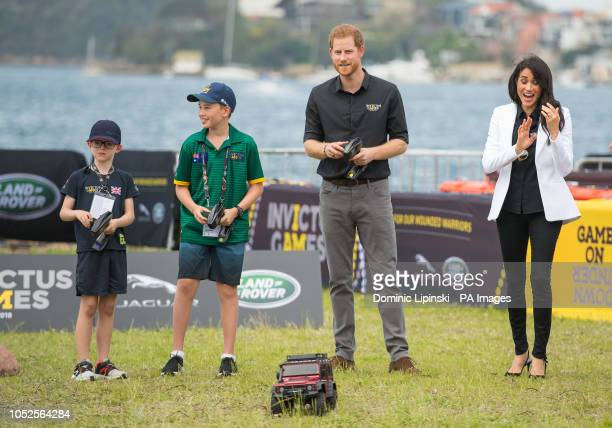 The Duke of Sussex drives a remote control car as the Duchess of Sussex looks on as they attend the Invictus Games Jaguar Land Rover Driving...