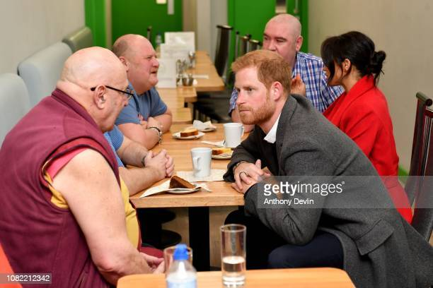 The Duke of Sussex ispeaks with members Kelsang Sonam as the Duke and Duchess of Sussex officially open Number 7 a Feeding Birkenhead citizens...