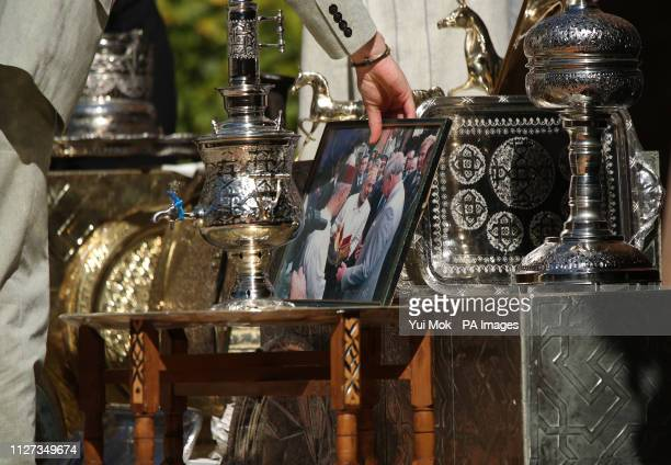 The Duke of Sussex spots a photograph of his father the Prince of Wales during a social entrepreneurs event and market at the Andalusian Gardens in...