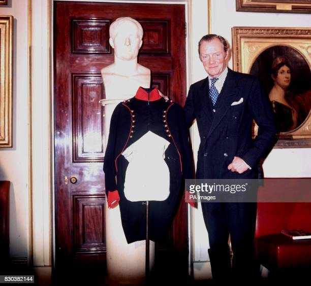 The Duke of Wellington at Apsley House with the red and blue tunic left by Napoleon Bonaparte on the Waterloo battlefield in June 1815. The tunic was...