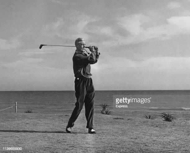 The Duke of Windsor playing golf during a holiday at Guadalmina in Spain, 30th January 1962. He is playing a match against racehorse owner Count...