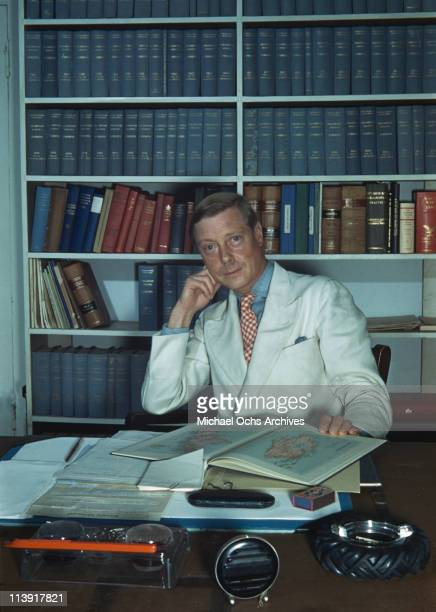 The Duke of Windsor sitting at a desk, which is strewn with books and paperwork in Goverment House in Nassau, the Bahamas, circa 1942. The Duke of...