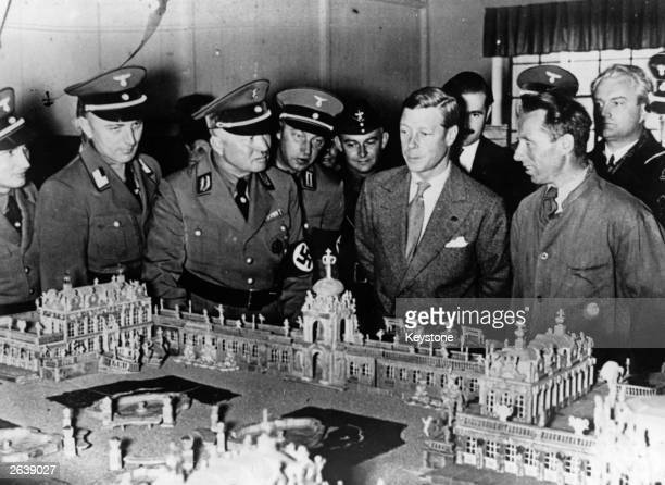 The Duke of Windsor who reigned in 1936 as King Edward VIII views a model of the Zwinger Palace Dresden during a visit to the German Labour School of...