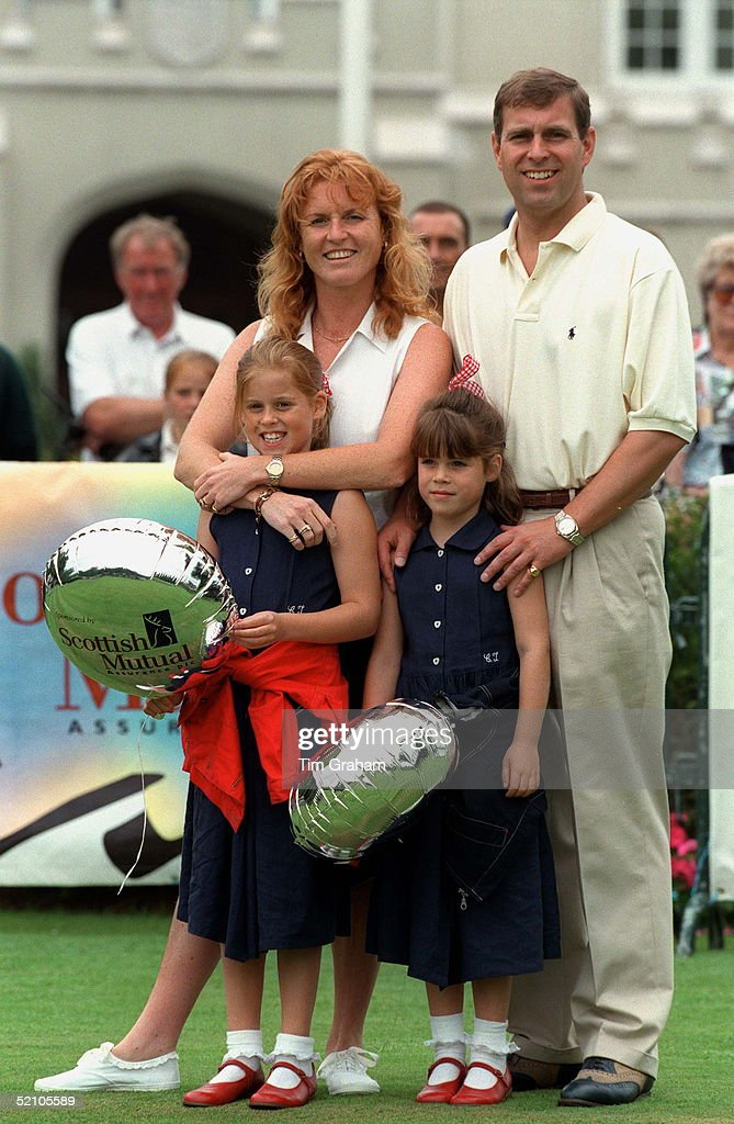 The Duke Of York And Sarah, Duchess Of York With Princess Beatrice & Princess Eugenie Holding Balloons At Wentworth Golf Club