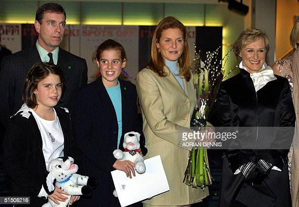 The Duke of York and Sarah Ferguson pose with their children Eugenie and Beatrice and US actress Glenn Close at the premiere of the new Disney movie...