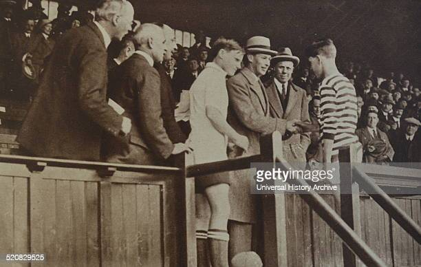The Duke of York, later King George VI is shown attending a football match between English and Scottish schoolboys at Stamford Bridge.