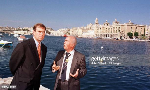 The Duke of York looks out over Maltas capital Valletta's grand harbour with Mr Hector Bruno the Mayor of Valletta this afternoon the Duke is on a...