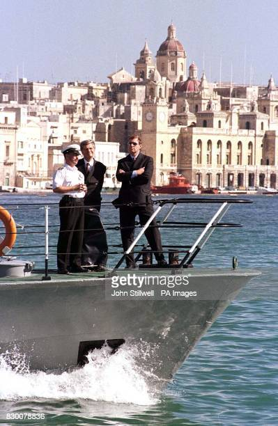 The Duke of York looks toward the sightseers on the dock side as he tours Valletta grand harbour in Malta this afternoon aboard a Maltese Navy boat...