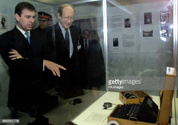 The Duke of York points at a rare World War II Enigma code breaking machine during his tour of Bletchley Park the former British spy centre as...