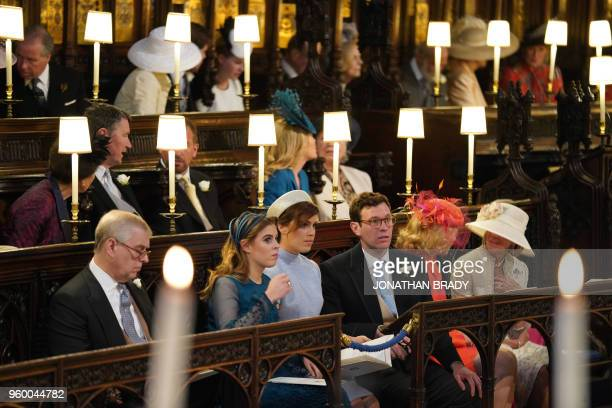 The Duke of York Princess Beatrice Princess Eugenie and Jack Brooksbank sit ahead of the wedding ceremony of Britain's Prince Harry Duke of Sussex...