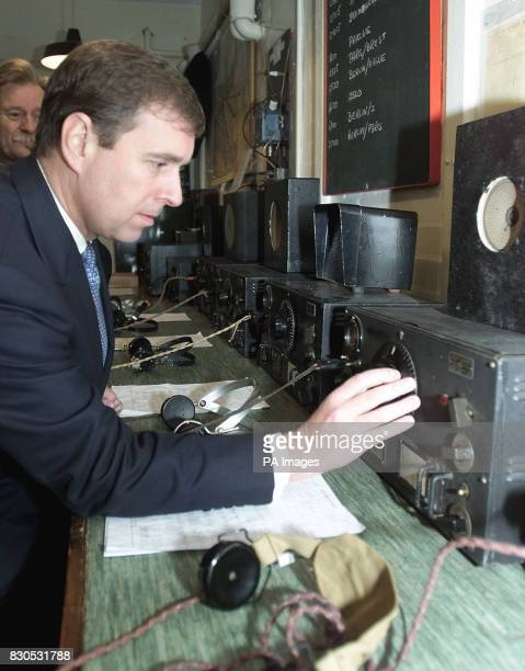 The Duke of York tries his hand at capturing radio signals during a tour of the Intercept Room at Bletchley Park Buckinghamshire the former British...