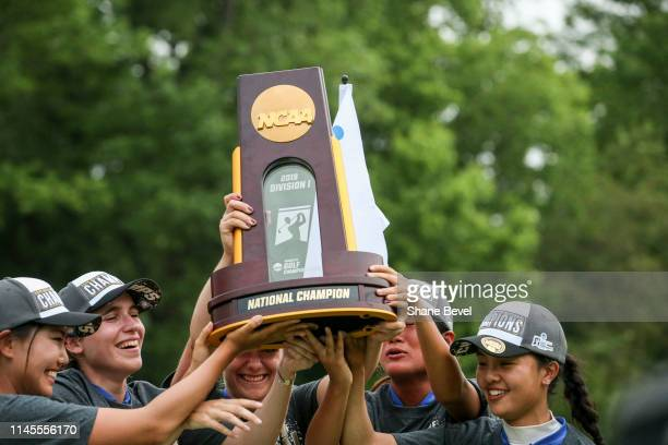 The Duke University Women's golf team hoist the trophy after winning the Division I Women's Golf Match Play Championship held at Blessings Golf Club...