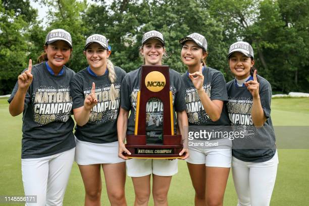 The Duke University Women's golf team poses with the trophy after winning the Division I Women's Golf Match Play Championship held at Blessings Golf...