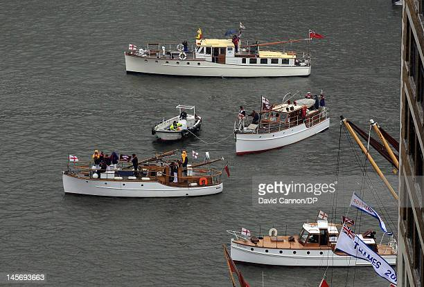 The Dunkirk Little Ships in the flotilla as seen from The Monument during The Diamond Jubilee Pageant on the River Thames on June 3 2012 in London...