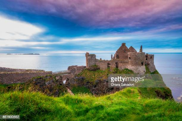 the dunluce castle - dunluce castle stock photos and pictures
